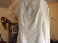 This beautiful wedding dress by L'Amour was purchased