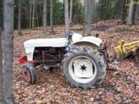 Satoh tractor with brush hog, back blade, and post hole