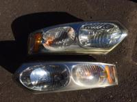 Set of two (2) headlamps for a Saturn Ion-2. Will fit