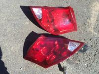 Set of two tail lights that will fit most Saturn Ion-2