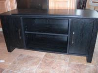 Sauder Panel TELEVISION Stand in black finish.