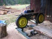Home built bandsaw sawmill. Presently on track under