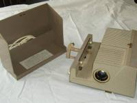 I am offering a Sawyer slide projector set including a