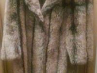 I have a Saxton hall fo racoon fur coat looking to sale