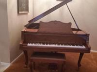 A beautiful baby grand piano good for Entertainment or