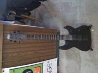 Schecter Diamond black 6 string guitar. In Excellent
