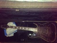 I have a Schecter Omen Extreme-6 guitar in trans black