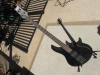 This is my 4 string, 24 fret Schecter bass. Great