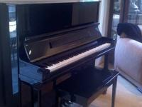 For Sale is a barely used Schirmer & Sons ebony piano.