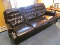 I have a gorgeous tufted black vintage naugahyde couch