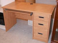 Nice school desk. Three drawers and pull-out keyboard