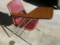 10 right hand and 1 left hand school student desks.