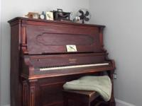 This beautiful turn of the century piano has actually