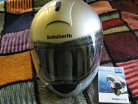 Never used Schuberth silver motorcycle helmet; size XL;