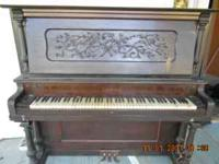 antique upright piano .....must be picked up..very