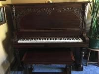 Schumann upright piano with matching bench. Beautiful