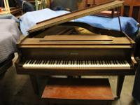 This piano would make a great starter baby grand. It