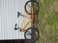 I am selling a yellow/orange beach cruiser bicycle for