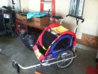 Schwinn blue/red/yellow 2-seater inclosed bike trailer.