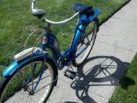 A 1950s Schwinn Rollfast Deluxe blue bicycle. Bike was