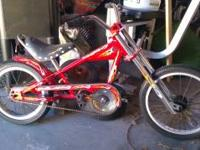 "This is a 16"" Red Schwinn Stingray Chopper Bicycle with"