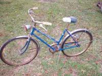 nice looking old schwinn ladies bicycle. fresh out of a
