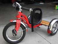 Great little Schwinn Tricycle with wood foot step on