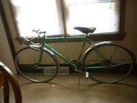 This is a Schwinn Varsity from the 1960's - could be