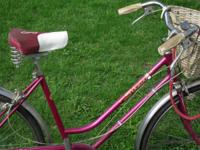 1972 Schwinn Deluxe Breeze. Red girls Schwinn bicycle.
