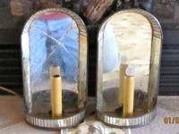 A pair of antique one light wall sconces, with glass