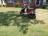 a scooter thats like new red with 700 miles on  it