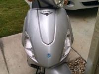 Gently used Piaggio Fly 150. About 1100 mi on it, great
