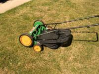 The Scotts 20 in. Reel Mower features a grass-catcher