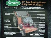 "SCOTTS LAWN MOWER 21"" , 6.5HP, FRONT WHEEL DRIVE. HAS"
