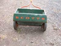 Good used scotts spreader. Model 35-8. It is a metal