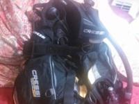 Two computers, BCD, regulator, masks,fins, wet suits,