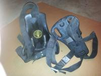 Two used SCUBA tank backpacks with straps and stainless