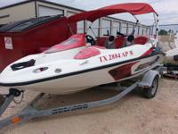 Sea Doo boat is for sale. It is a 14ft. long boat.  On