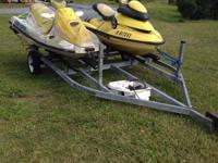For sale is a pair of Sea Doo Jet skis. THE TRAILER IS