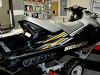 A beautiful 3 passenger jet ski, wave runner, personal