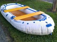 Sea Eagle 9 foot inflatable boat with wood seats, floor