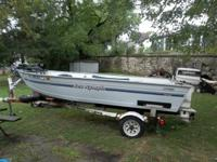 1994 SEA NYMPH V-BOTTOM BOAT AND TRAILOR. HAS A 25 HP