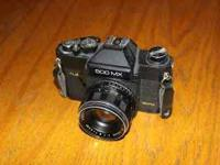 Up for sale is a Sears 500 MX SLR camera. It fires on