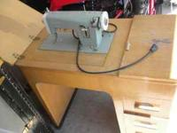 Old fashion sewing machine, good condition for age.
