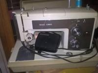 Older sears Kenmore sewing machine works has hard case