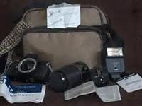 . HAS TELEPHOTO LENS,FLASH,STRAP, CASE, EVERYTHING