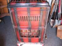 for sale is an old antique gas heating stove made by