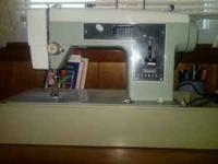 Sewing machine in excellent conditions contact Mary Ann