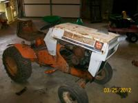 FOR SALE IS AN OLD SEARS SUBURBAN LAWN TRACTOR. NEEDS