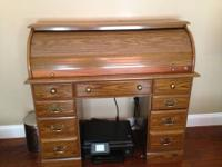 This is a gorgeous secretary Roll top desk very sturdy